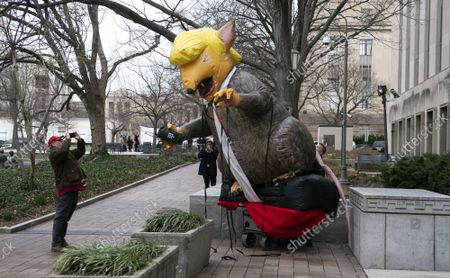 Stock Photo of Protesters set up an inflatable Trump Ray outside of the E. Barrett Prettyman Courthouse as Roger Stone, the former Trump campaign advisor, was sentenced to 40 months for lying to Congress and witness tampering, in Washington, D.C. on Thursday, February 20, 2020. President Trump has continually said Sone has been treated unfairly by prosecutors and called for a reduction in sentencing recommendations.