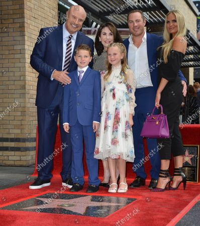Stock Image of (L-R, back row) Dr. Phil McGraw, his wife Robin McGraw, his son Jay McGraw, Erica Dahm and Dr. Phil's grandkids London and Avery (front row) attend the star unveiling ceremony honoring him with the 2,688th star on the Hollywood Walk of Fame in Los Angeles, California on February 21, 2020.