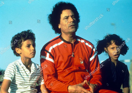Colonel Muammar Gaddafi with his son Hannibal (b: 1973), left, and his daughter Ayesha (b: 1977) in Bab Azizia Palace grounds after the 8 May 1984 coup attempt against him.