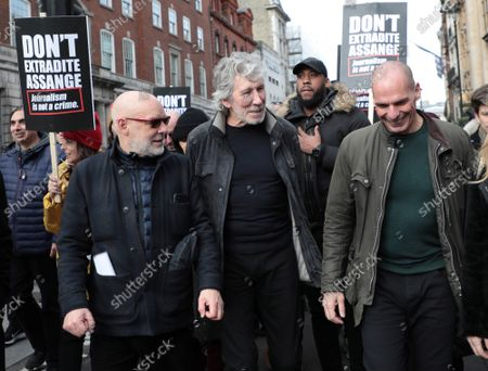 L-R Musician Brian Eno, Roger Waters and politician Yanis Varoufakis walk in protest with hundreds of activists fighting to stop the extradition of Julian Assange to the United States for committing espionage charges against the American government on Saturday, February 22, 2020 in London. The trial to extradite Julian Assange begins on Monday in London on February 24 2020.