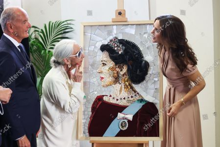 Maurizio Giani, Rossana Orlandi and Princess Mary with a portrait of her made with recycled materials during the visit of the Danish installations and companies at the Museum of Science and Technology at the Fuorisalone 2021