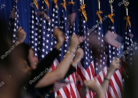 Supporters holding American Flags wait for Democratic presidential candidate Mike Bloomberg to deliver a speech announcing that he is suspending his campaign on Wednesday, March 4, 2020 in New York City. Bloomberg endorsed Joe Biden saying the former vice president had the best chance to win in November.