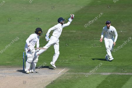 John Simpson leaps to catch the ball during the LV= Insurance County Championship match between Sussex County Cricket Club and Middlesex County Cricket Club at the 1st Central County Ground, Hove
