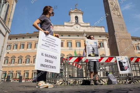 """Protest in front of Montecitorio Palace in Rome organized by association """"Italiani per Assange"""" to ask for release and political asylum for Julian Assange, journalist currently detained in maximum security prison of Belmarsh in the United Kingdom, with US extradition request."""