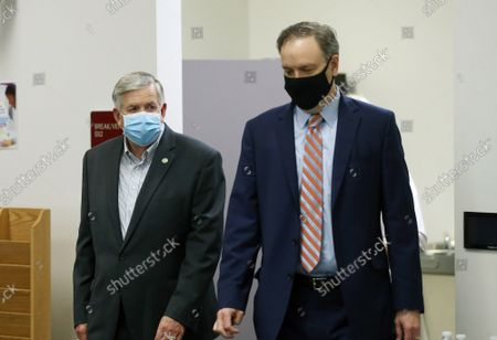 Missouri Governor Mike Parson (L) and St. Louis County Executive Dr. Sam Page, enter the room to talk to reporters, in Clayton, Missouri on Friday, May 29, 2020. Parson gave the State coronavirus update, extending Phase 1 of the states opening plan to June 15, 2020.
