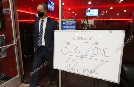 St. Louis County Executive Dr. Sam Page leaves the Burn Zone Room at the Club Fitness Gym, during a tour in Maplewood, Missouri on Monday, June 15, 2020. Page was on hand to announce that all businesses are now open in St. Louis County, following three months of closure, due to the Coronavirus pandemic. Most businesses are only allowing only 25 per cent capacity, with those numbers to grow in the following weeks.