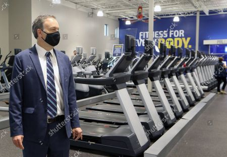 St. Louis County Executive Dr. Sam Page looks over the Club Fitness Gym, during a tour in Maplewood, Missouri on Monday, June 15, 2020. Page was on hand to announce that all businesses are now open in St. Louis County, following three months of closure, due to the Coronavirus pandemic. Most businesses are only allowing only 25 per cent capacity, with those numbers to grow in the following weeks.