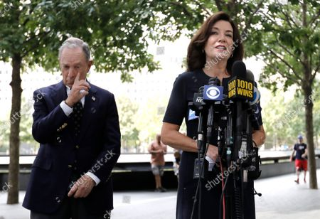 Stock Picture of New York Gov. Kathy Hochul (R) speaks to the media along with Former Mayor Mike Bloomberg (L) after laying flowers at the edge of the south memorial pool to commemorate the 20th anniversary of the September 11 terror attack in New York, New York, USA, 08 September 2021. On 11 September 2001, during a series of coordinated terror attacks using hijacked airplanes, two airplanes were flown into the World Trade Center's twin towers causing the collapse of both towers. A third plane targeted the Pentagon and a fourth plane heading towards Washington, DC ultimately crashed into a field. The 20th anniversary of the worst terrorist attack on US soil will be observed on 11 September 2021.