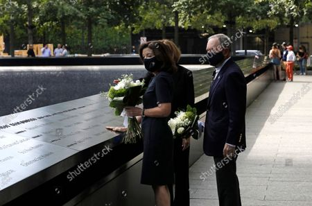 New York Gov. Kathy Hochul (L) and former New York City Mayor Mike Bloomberg arrive to lay flowers at the edge of the south memorial pool to commemorate the 20th anniversary of the September 11 terror attack in New York, New York, USA, 08 September 2021. On 11 September 2001, during a series of coordinated terror attacks using hijacked airplanes, two airplanes were flown into the World Trade Center's twin towers causing the collapse of both towers. A third plane targeted the Pentagon and a fourth plane heading towards Washington, DC ultimately crashed into a field. The 20th anniversary of the worst terrorist attack on US soil will be observed on 11 September 2021.