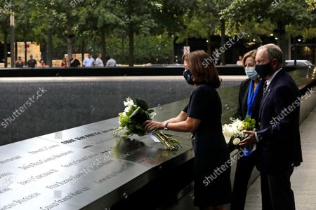 Stock Photo of New York Gov. Kathy Hochul (L) and former New York City Mayor Mike Bloomberg (R) are joined by 9/11 Memorial and Museum Director Alice Greenwald (C) as they lay flowers at the edge of the south memorial pool to commemorate the 20th anniversary of the September 11 terror attack in New York, New York, USA, 08 September 2021. On 11 September 2001, during a series of coordinated terror attacks using hijacked airplanes, two airplanes were flown into the World Trade Center's twin towers causing the collapse of both towers. A third plane targeted the Pentagon and a fourth plane heading towards Washington, DC ultimately crashed into a field. The 20th anniversary of the worst terrorist attack on US soil will be observed on 11 September 2021.