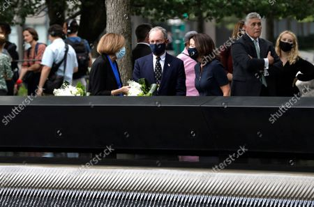 New York Gov. Kathy Hochul (R) and former New York City Mayor Mike Bloomberg (C) are joined by 9/11 Memorial and Museum Director Alice Greenwald (C) after  laying flowers at the edge of the south memorial pool to commemorate the 20th anniversary of the September 11 terror attack in New York, New York, USA, 08 September 2021. On 11 September 2001, during a series of coordinated terror attacks using hijacked airplanes, two airplanes were flown into the World Trade Center's twin towers causing the collapse of both towers. A third plane targeted the Pentagon and a fourth plane heading towards Washington, DC ultimately crashed into a field. The 20th anniversary of the worst terrorist attack on US soil will be observed on 11 September 2021.