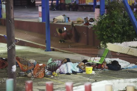 Locals sleep at a park after a strong earthquake in Acapulco, Mexico, . The earthquake shook southern Mexico near the Acapulco tourist complex, causing buildings to sway and sway in the City. from Mexico almost 200 miles away
