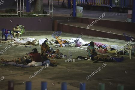 Stock Image of Locals sleep at a park after a strong earthquake in Acapulco, Mexico, . The earthquake shook southern Mexico near the Acapulco tourist complex, causing buildings to sway and sway in the City. from Mexico almost 200 miles away