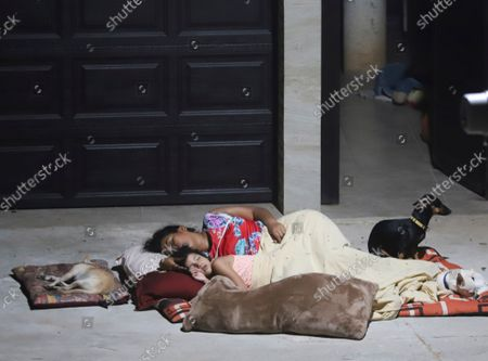 Stock Picture of Locals sleep outside their home after a strong earthquake in Acapulco, Mexico, . The earthquake shook southern Mexico near the Acapulco resort complex, causing buildings to sway and sway in the Mexico City almost 200 miles away