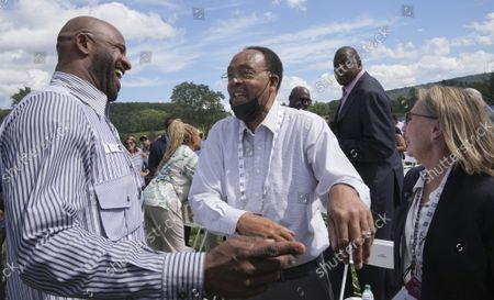 Stock Picture of Yankees pitcher CC Sabathia greets Charles Jeter (C) and Dot Jeter, with NBA legend Patrick Ewing walking in the background after arriving on the grounds during Major League Baseball's Hall of Fame Induction Ceremony 2021 for the 2020 inductees in Cooperstown, New York on Wednesday, September 8, 2021.  Derek Jeter, Ted Simmons, Larry Walker and players' union leader Marvin Miller will be inducted into the HOF during the event.