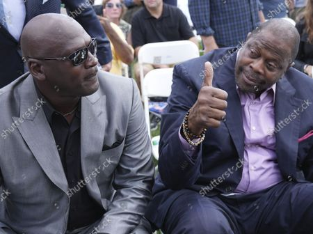 NBA stars Michael Jordan (L) and Patrick Ewing arrive for the  Major League Baseball's Hall of Fame Induction Ceremony 2021 for the 2020 inductees in Cooperstown, New York on Wednesday, September 8, 2021.  Derek Jeter, Ted Simmons, Larry Walker and players' union leader Marvin Miller will be inducted into the HOF during the event.