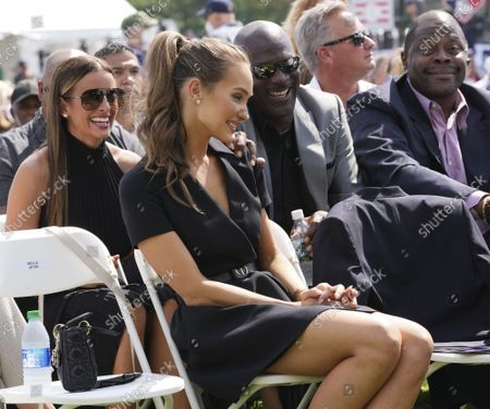 Hannah Jeter (second from left), wife of NY Yankees shortstop Derek Jeter, talks to NBA stars Michael Jordan (C) and Patrick Ewing after arriving during Major League Baseball's Hall of Fame Induction Ceremony 2021 for the 2020 inductees in Cooperstown, New York on Wednesday, September 8, 2021.  Derek Jeter, Ted Simmons, Larry Walker and players' union leader Marvin Miller will be inducted into the HOF during the event.