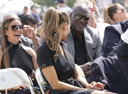 Hannah Jeter (C), wife of NY Yankees shortstop Derek Jeter, talks to NBA star Michael Jordan (R) after arriving during Major League Baseball's Hall of Fame Induction Ceremony 2021 for the 2020 inductees in Cooperstown, New York on Wednesday, September 8, 2021.  Derek Jeter, Ted Simmons, Larry Walker and players' union leader Marvin Miller will be inducted into the HOF during the event.