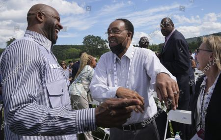 Stock Photo of Yankees pitcher CC Sabathia greets Charles Jeter (C) and Dot Jeter, with NBA legend Patrick Ewing walking in the background after arriving on the grounds during Major League Baseball's Hall of Fame Induction Ceremony 2021 for the 2020 inductees in Cooperstown, New York on Wednesday, September 8, 2021.  Derek Jeter, Ted Simmons, Larry Walker and players' union leader Marvin Miller will be inducted into the HOF during the event.