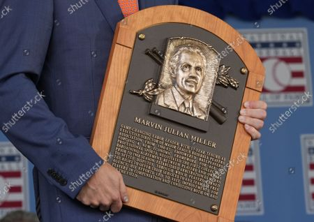 President of HOF Jeff Idelson presents the plague of the late Marvin Miller during baseeball's Hall of Fame Induction Ceremony 2021 for the 2020 inductees in Cooperstown, New York on Wednesday, September 8, 2021.  Derek Jeter, Ted Simmons, Larry Walker and players' union leader Marvin Miller will be inducted into the HOF during the event.