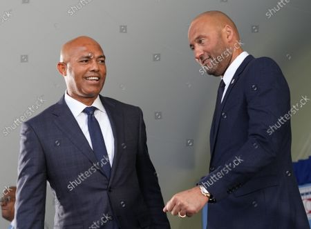 Hall of Famer Mariano Rivera (L) greets Derek Jeter after baseball's Hall of Fame Induction Ceremony 2021 for the 2020 inductees in Cooperstown, New York on Wednesday, September 8, 2021.  Derek Jeter, Ted Simmons, Larry Walker and players' union leader Marvin Miller will be inducted into the HOF during the event.
