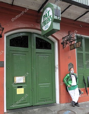 Pat O'Brien's in the French Quarter closes down in advance of Hurricane Zeta as the storm approaches the New Orleans area, October 28, 2020.