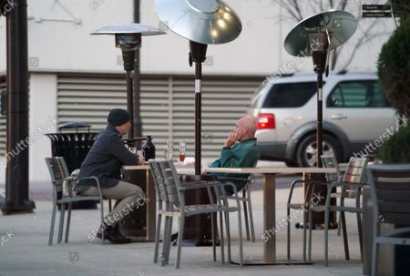 Patrons at Peel Wood Fired Pizza, brave the 45 degrees temperatures to enjoy a beverage outdoors in Clayton, Missouri on Tuesday, November 17, 2020. Due to the COVID-19 spreading in record numbers, St. Louis County Executive Dr. Sam Page has ordered all restaurants in St. Louis County, closed for indoor seating, however curbside pickup and outdoor seating is still permitted. All people over five years of age must wear a mask when leaving home.