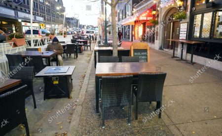 A customer sits among empty tables, in the 45 degree temperatures in University City, Missouri on Tuesday, November 17, 2020. Due to the COVID-19 spreading in record numbers, St. Louis County Executive Dr. Sam Page has ordered all restaurants in St. Louis County, closed for indoor seating, however curbside pickup and outdoor seating is still permitted. All people over five years of age must wear a mask when leaving home.