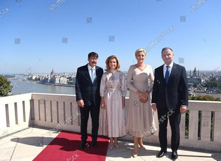 Polish President Andrzej Duda (R), his wife Agata Kornhauser-Duda (2ND R), Hungarian President Janos Ader (L) and his wife Anita Herczeg (2N L) pose for the photographer on the terrace of the presidential Alexander Palace in Budapest, Hungary, 09 September 2021. President Duda is in Hungary on an official visit.