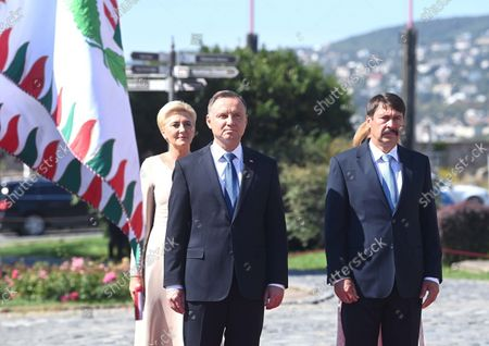 Polish President Andrzej Duda (2ND L), his wife Agata Kornhauser-Duda (L) and his Hungarian counterpart Janos Ader (R) listen to the national anthems during the welcoming ceremony at the presidential Alexander Palace in Budapest, Hungary, 09 September 2021. President Duda is in Hungary on an official visit.
