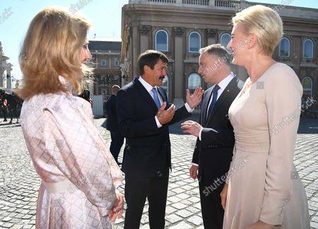Polish President Andrzej Duda (2ND R) and his wife Agata Kornhauser-Duda (R) are greeted by Hungarian President Janos Ader (2ND L) and his wife Anita Herczeg (L) at the presidential Alexander Palace in Budapest, Hungary, 09 September 2021. President Duda is in Hungary on an official visit.