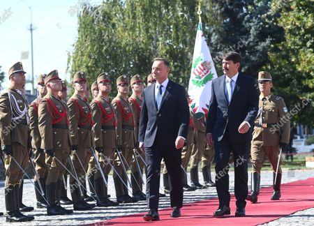 Polish President Andrzej Duda (L) and his Hungarian counterpart Janos Ader (R) review the honour guards during th ewelcoming ceremony at the presidential Alexander Palace in Budapest, Hungary, 09 September 2021. President Duda is in Hungary on an official visit.