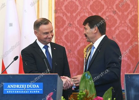 Polish President Andrzej Duda (L) and his Hungarian counterpart Janos Ader (R) shake hands at the end of their joint press conference after their talks in the presidential Alexander Palace in Budapest, Hungary, 09 September 2021. Duda is on an official visit in Hungary.