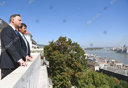 Polish President Andrzej Duda (L) and his Hungarian counterpart Janos Ader view the panorama from the terrace of the presidential Alexander Palace, at right the Parliament building on the bank of River Danube is seen in Budapest, Hungary, 09 September 2021. Duda is on an official visit in Hungary.