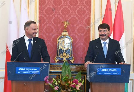 Stock Photo of Polish President Andrzej Duda (L) and his Hungarian counterpart Janos Ader (R) share a light moment during their joint press conference after their talks in the presidential Alexander Palace in Budapest, Hungary, 09 September 2021. Duda is on an official visit in Hungary.