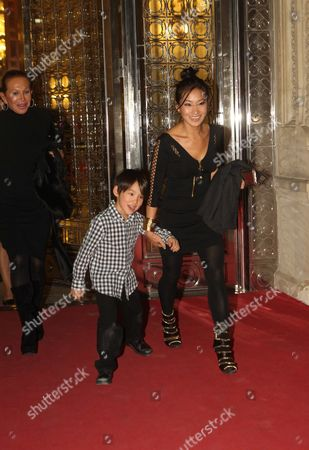 Stock Picture of Alice Kim and her son Kal-El Cage