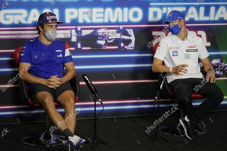 Alpine driver Fernando Alonso of Spain and Haas driver Mick Schumacher of Germany attend a press conference ahead of Sunday's Italian Formula One Grand Prix, at the Monza racetrack, in Monza, Italy