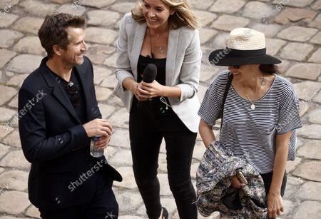 Stock Picture of French actress Marion Cotillard (R) and French actor Guillaume Canet (L) attend a tribute ceremony for late French actor Jean-Paul Belmondo at the Hotel des Invalides in Paris, France, Paris, 09 September 2021. Belmondo died on 06 September 2021 at the age of 88 years.