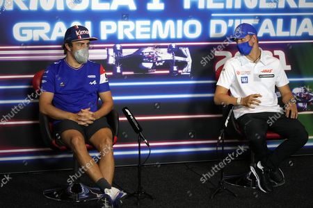 Spanish Formula One driver Fernando Alonso of Alpine F1 Team (L) and  German Formula One driver Mick Schumacher of Haas F1 Team during a press conference prior the Formula One Grand Prix of Italy at the Autodromo Nazionale Monza race track in Monza, Italy, 09 September 2021.