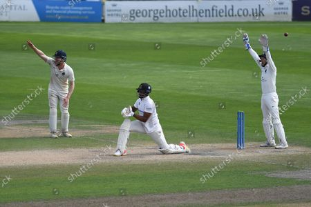 Sam Robson and John Simpson appeal for LBW against Delray Rawlins during the LV= Insurance County Championship match between Sussex County Cricket Club and Middlesex County Cricket Club at the 1st Central County Ground, Hove