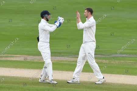 Wicket. 108 - 4.  Luke Hollman is congratulated by John Simpson after the pair combined to dismiss George Garton of Sussex during the LV= Insurance County Championship match between Sussex County Cricket Club and Middlesex County Cricket Club at the 1st Central County Ground, Hove
