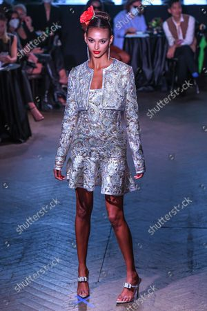 A model on the runway at the Naeem Khan show as part of New York Fashion Week