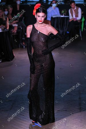 Stock Image of A model on the runway at the Naeem Khan show as part of New York Fashion Week