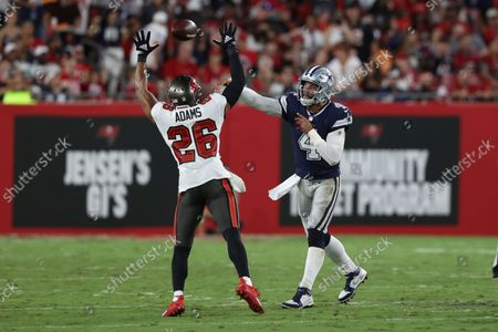 Stock Image of Dallas Cowboys quarterback Dak Prescott (4) passes over Tampa Bay Buccaneers safety Andrew Adams (26) during the second half of an NFL football game, in Tampa, Fla