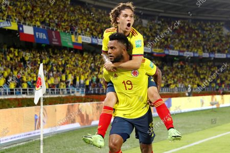 Colombia's Miguel Borja (bottom) celebrates with his teammate Juan Quintero after scoring during the soccer match of the South American qualifiers for the Qatar 2022 World Cup between Colombia and Chile, at the Metropolitano Stadium in Barranquilla, Colombia, 09 September 2021.