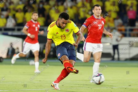 Colombia's Miguel Borja scores a penalty kick during the soccer match of the South American qualifiers for the Qatar 2022 World Cup between Colombia and Chile, at the Metropolitano Stadium in Barranquilla, Colombia, 09 September 2021.