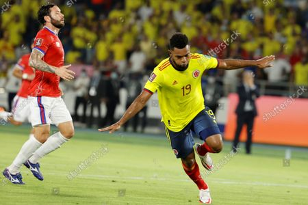 Colombia's Miguel Borja celebrates after scoring a penalty kick during the soccer match of the South American qualifiers for the Qatar 2022 World Cup between Colombia and Chile, at the Metropolitano Stadium in Barranquilla, Colombia, 09 September 2021.