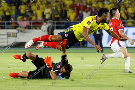 Colombia's Miguel Angel Borja (top) in action against Chile's goalkeeper Claudio Bravo during the South American qualifiers for the Qatar 2022 World Cup between Colombia and Chile, at the Metropolitano Stadium in Barranquilla, Colombia, 09 September 2021.