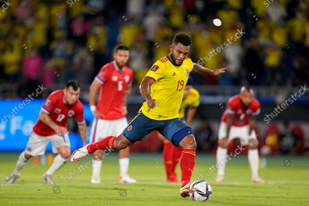 Colombia's Miguel Borja scores from the penalty spot his side's first goal against Chile during a qualifying soccer match for the FIFA World Cup Qatar 2022 in Barranquilla, Colombia