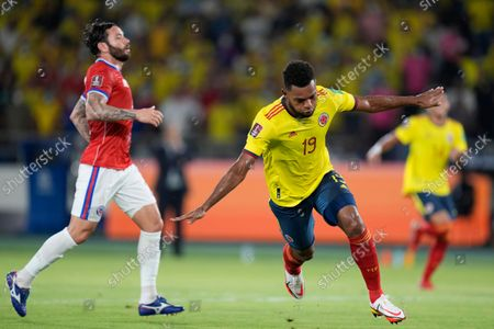 Colombia's Miguel Borja celebrates scoring his side's second goal against Chile during a qualifying soccer match for the FIFA World Cup Qatar 2022 in Barranquilla, Colombia